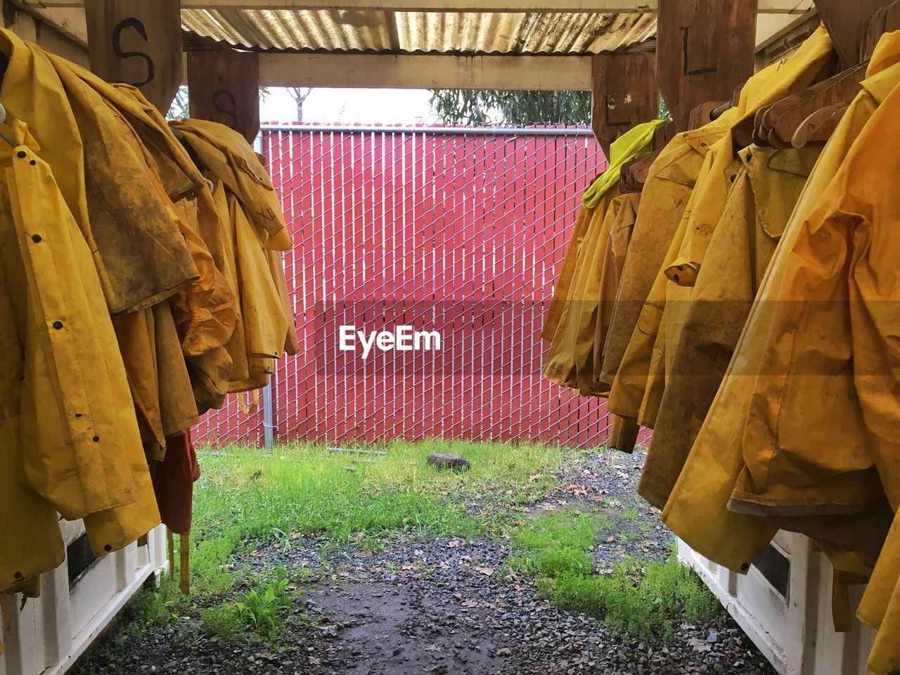 Yellow Workwear Hanging In Shed