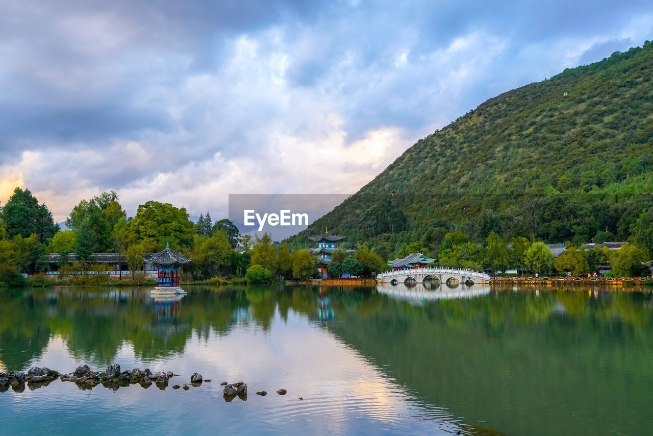 sky, reflection, water, cloud - sky, lake, scenics, tranquil scene, nature, tranquility, beauty in nature, tree, mountain, day, outdoors, no people, idyllic, waterfront, growth, animal themes, architecture, bird