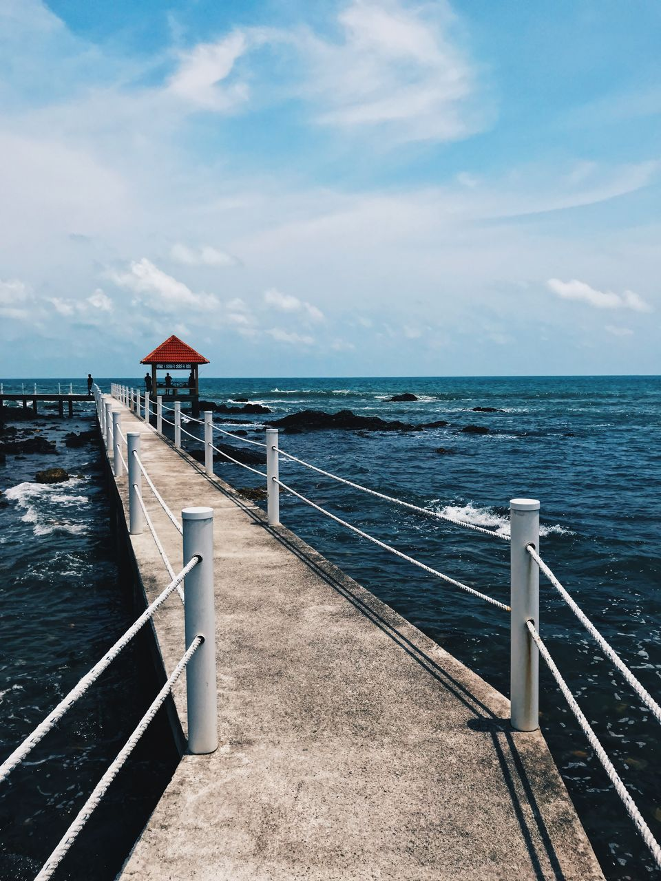 sea, water, sky, cloud - sky, railing, architecture, horizon, scenics - nature, beauty in nature, horizon over water, built structure, nature, day, tranquility, tranquil scene, no people, land, beach, pier, outdoors