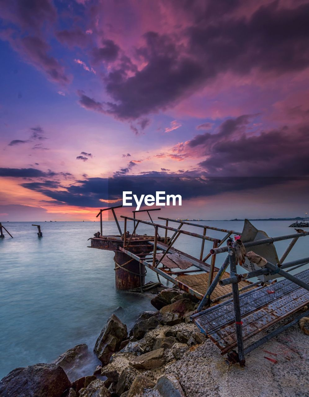 sky, water, sunset, cloud - sky, sea, beauty in nature, scenics - nature, tranquil scene, land, tranquility, beach, rock, nature, horizon over water, solid, idyllic, horizon, rock - object, no people, outdoors