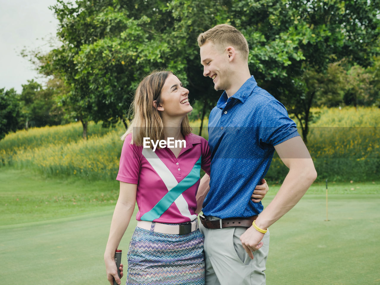 two people, togetherness, women, leisure activity, standing, couple - relationship, young adult, emotion, adult, bonding, heterosexual couple, young women, love, young men, grass, men, casual clothing, plant, lifestyles, positive emotion, boyfriend, outdoors