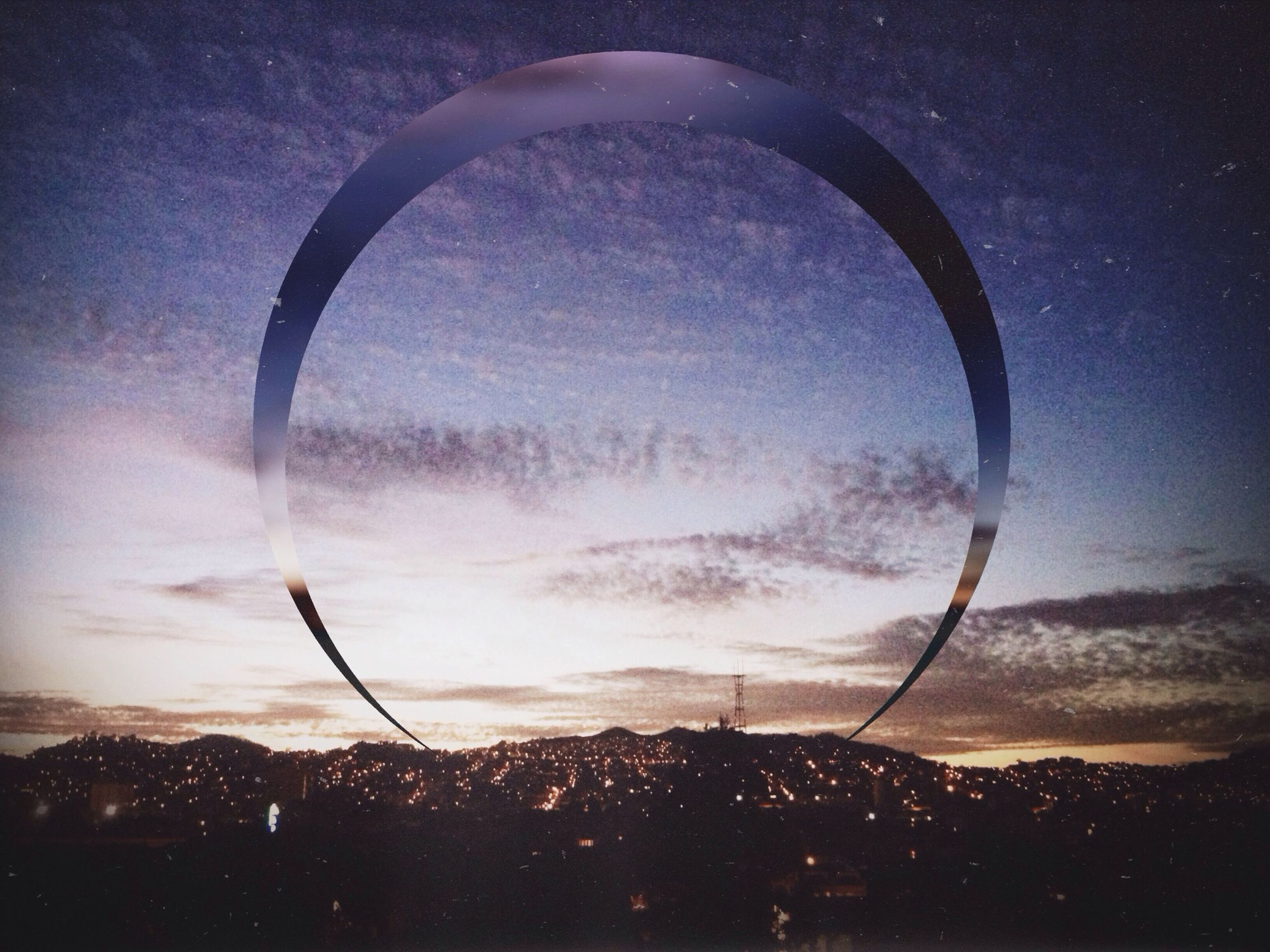 sky, sunset, silhouette, cloud - sky, scenics, beauty in nature, nature, dusk, sphere, tranquility, circle, mid-air, tranquil scene, transparent, landscape, outdoors, cloud, planetary moon, low angle view, no people