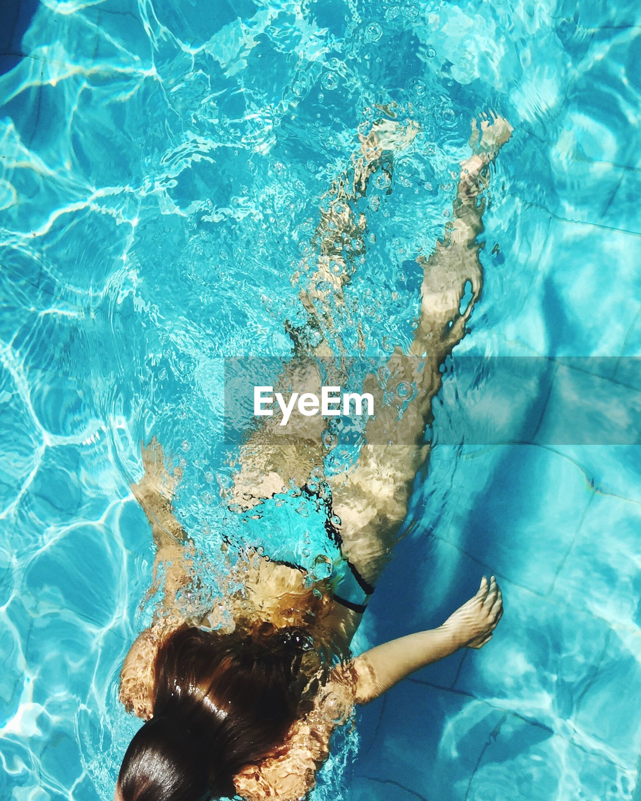 water, swimming pool, blue, swimming, lifestyles, leisure activity, low section, underwater, high angle view, person, barefoot, turquoise colored, sea, refreshment, rippled, waterfront