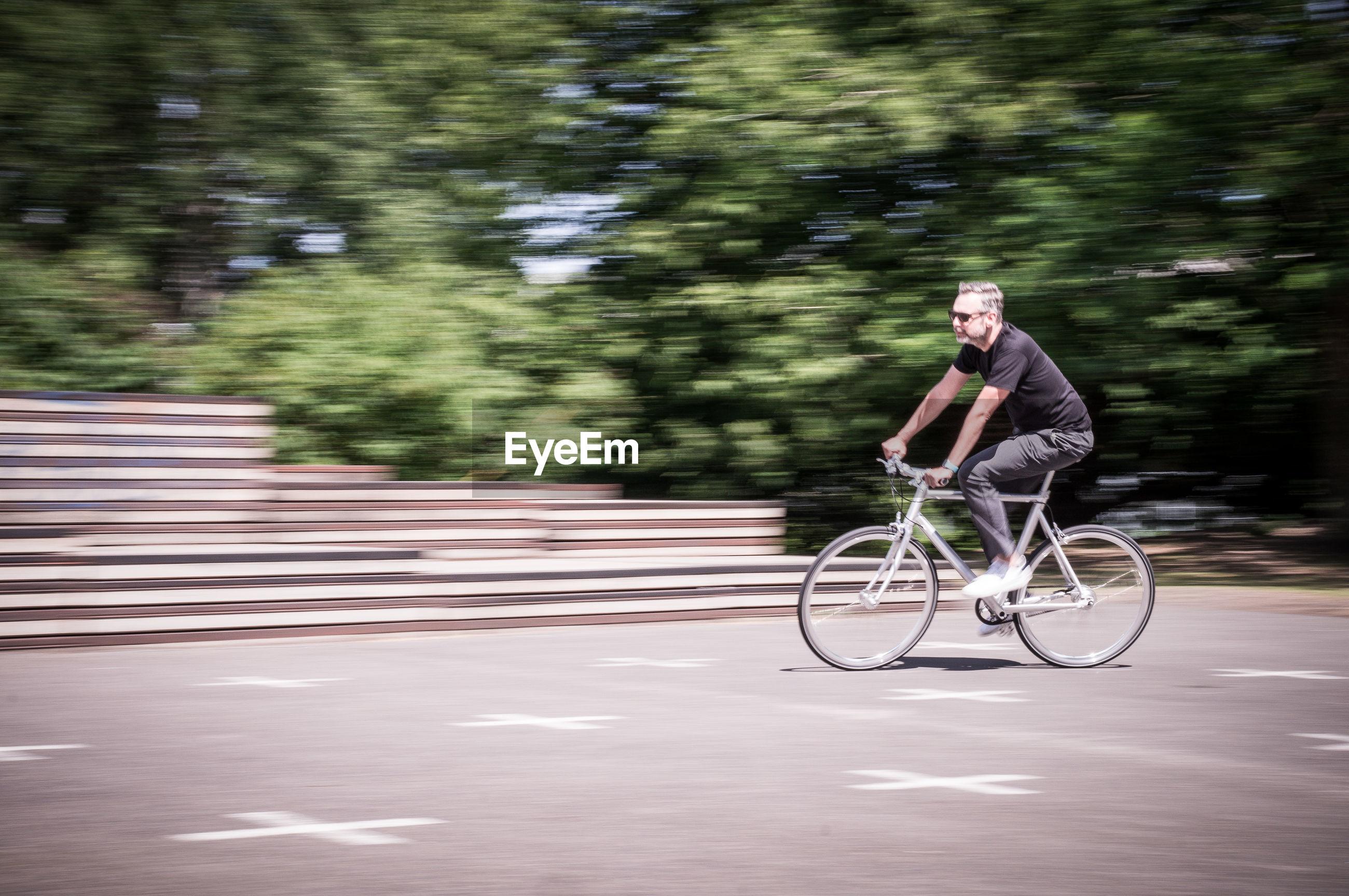 Man riding bicycle on road