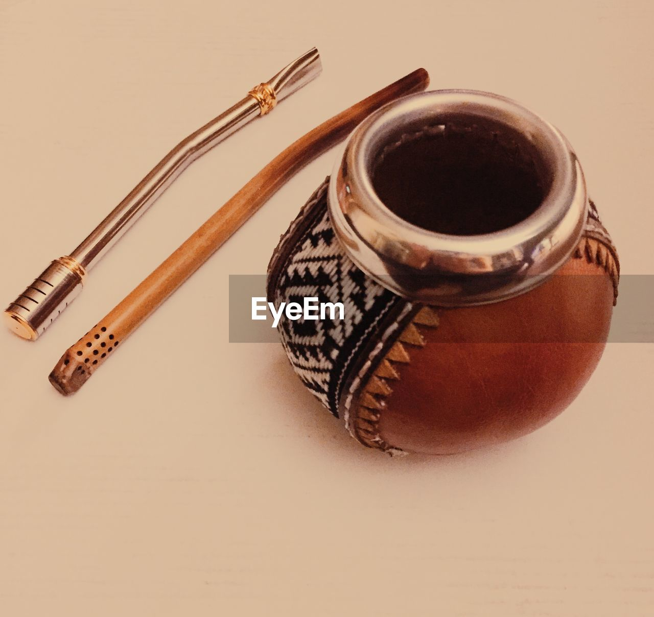 High angle view of container and drinking straws on yerba mate