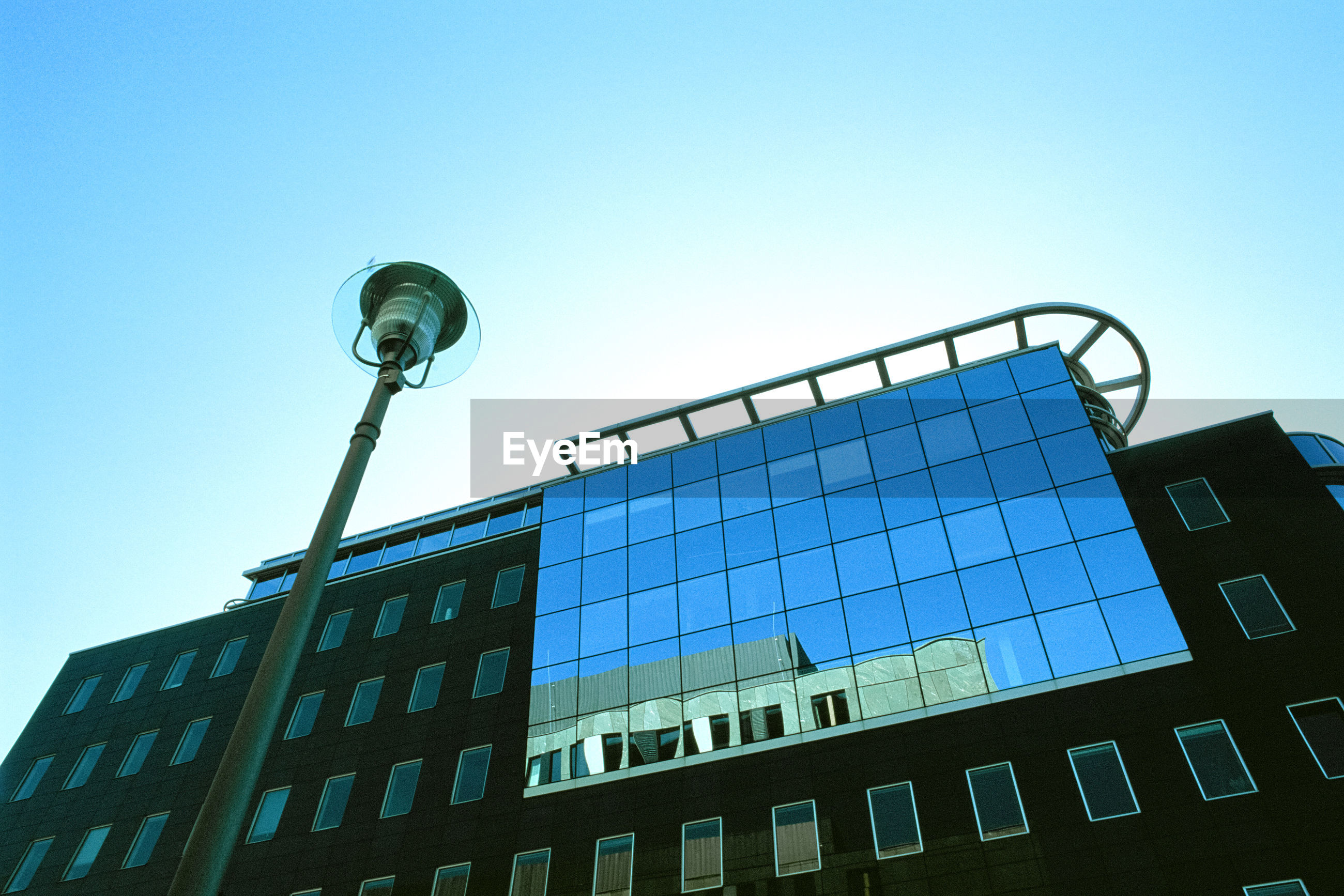 low angle view, architecture, building exterior, built structure, clear sky, no people, blue, window, day, outdoors, sky, city