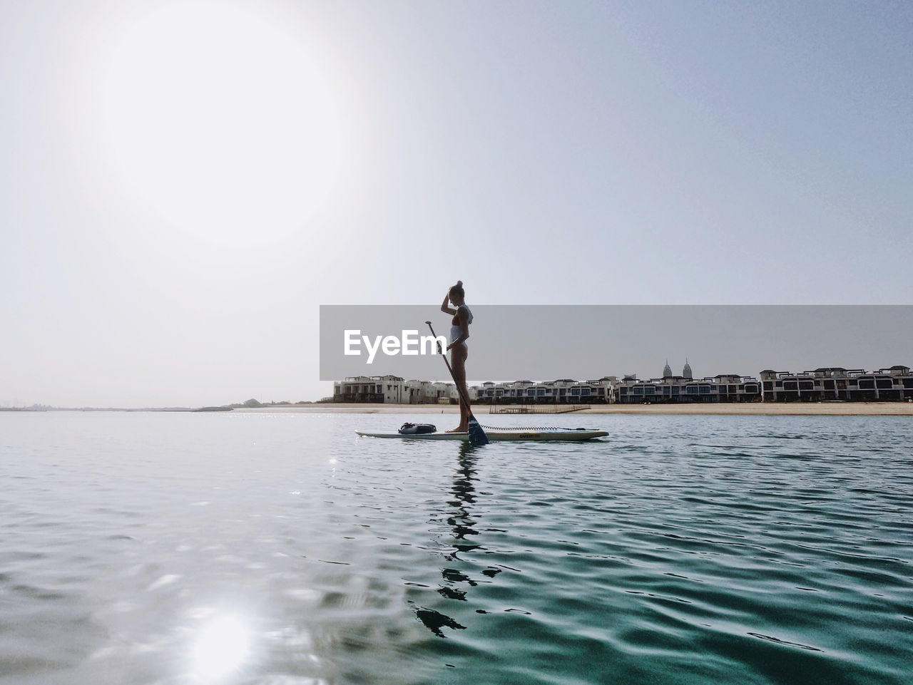 Woman doing stand up paddle boarding
