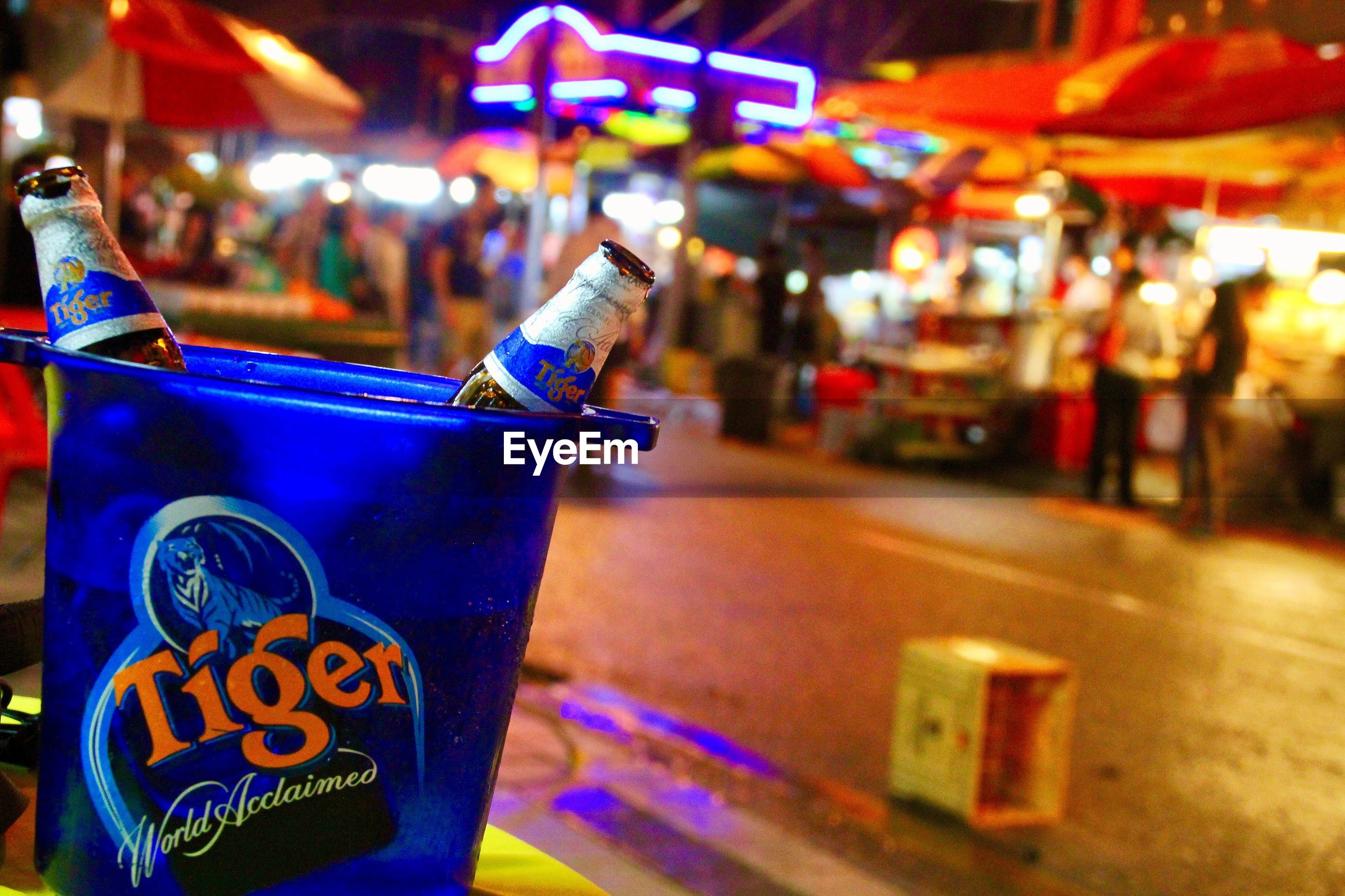 CLOSE-UP OF DRINK IN CITY AT NIGHT