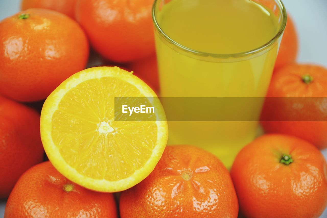 Close-Up Of Oranges And Juice
