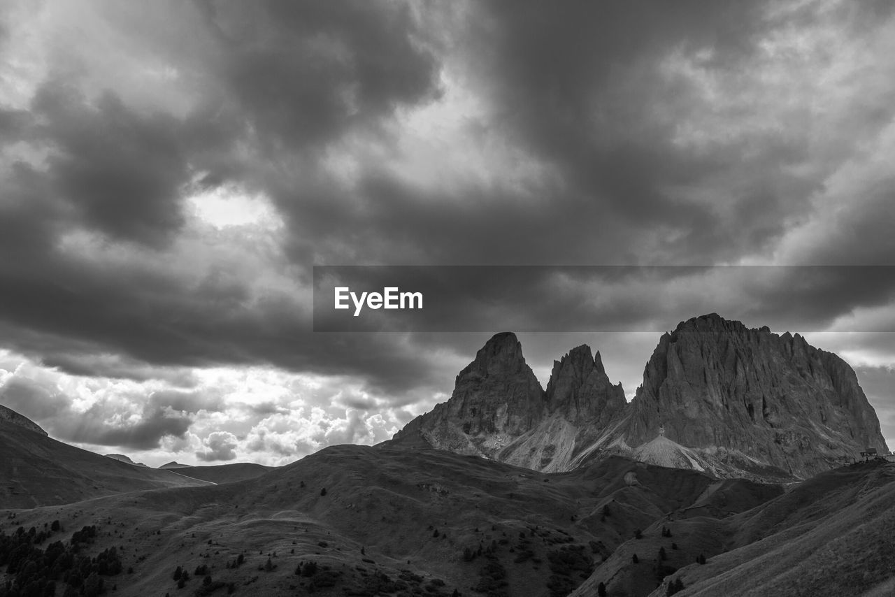 Idyllic view of mountains against cloudy sky