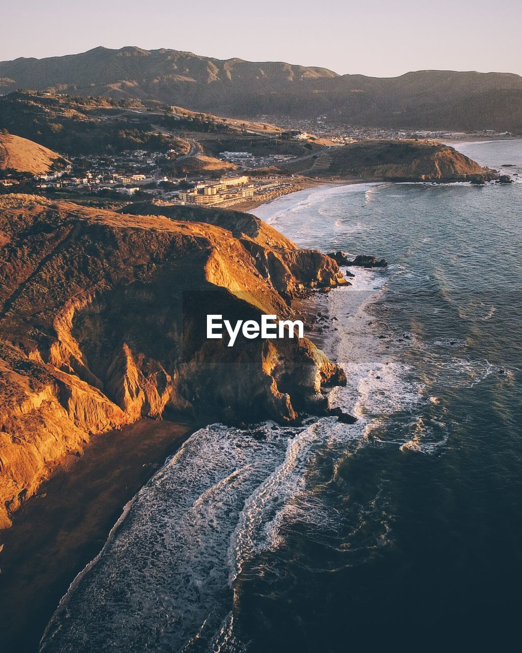 Aerial View Of Coastline During Sunset