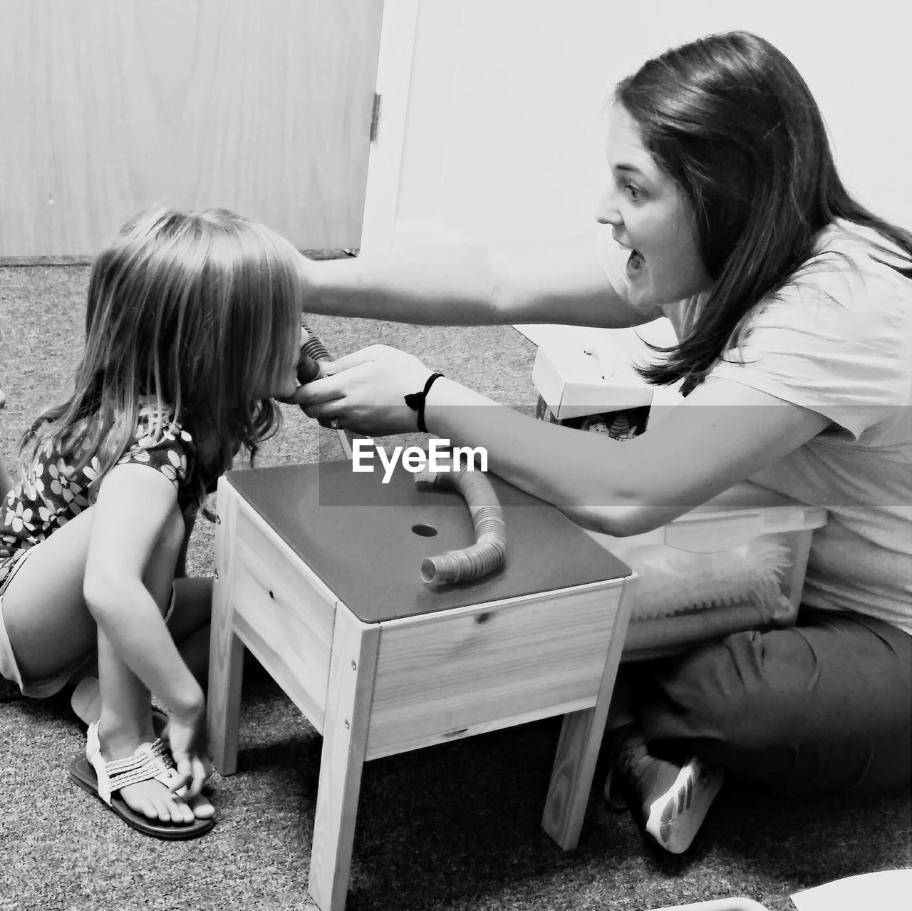 Mother Teaching Daughter Speech Therapy At Home