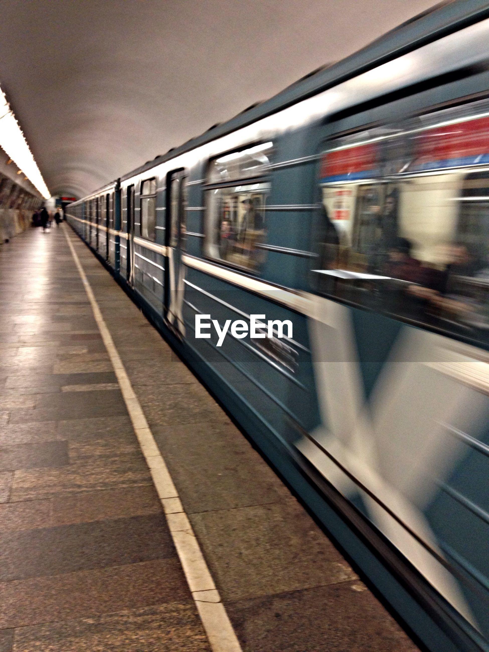 Blurred motion of subway train at station
