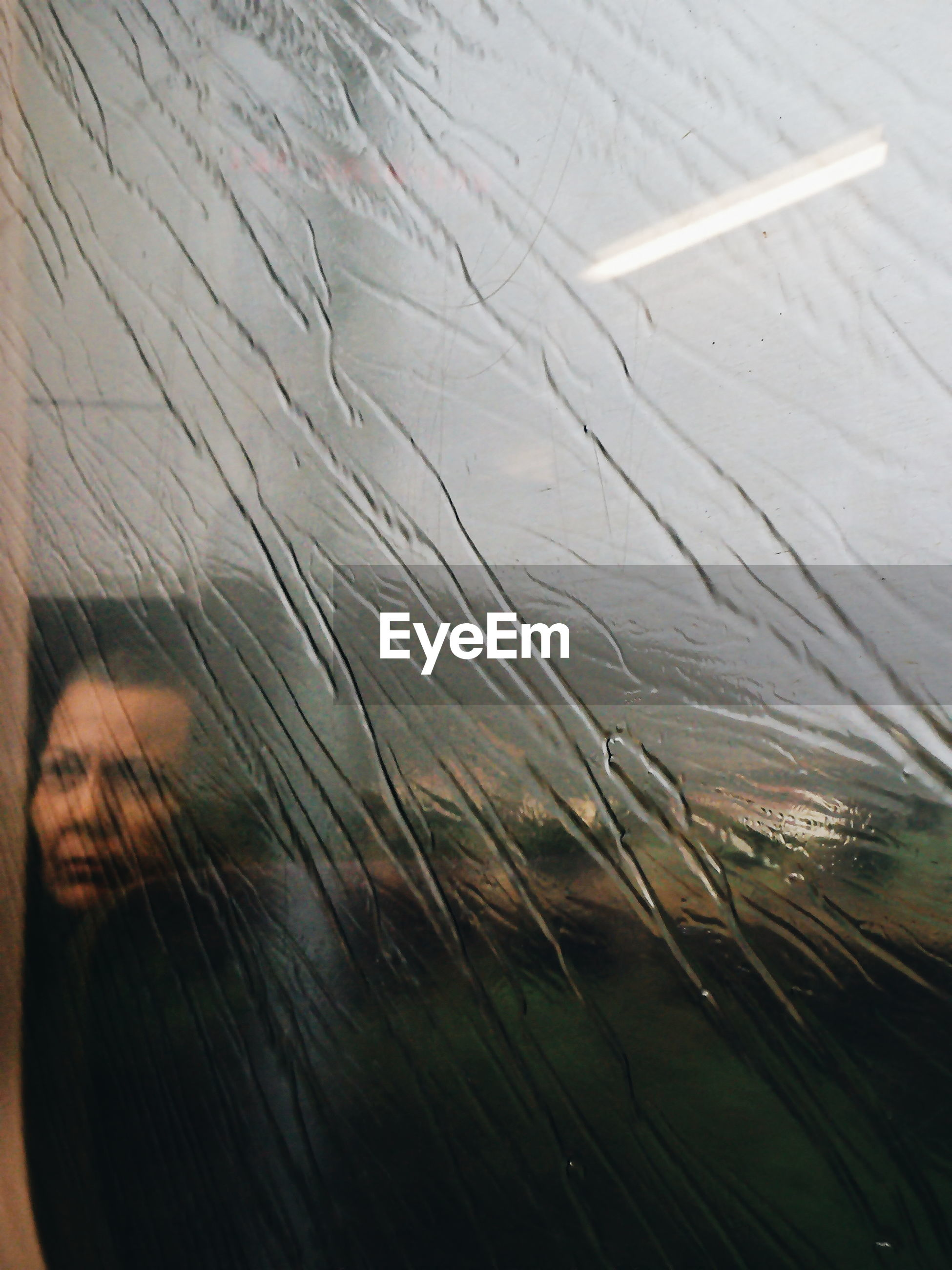 Woman seen through window