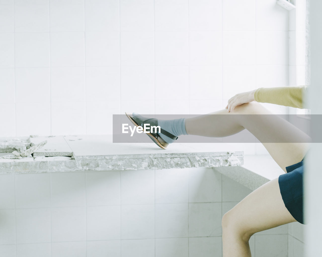 Low Section Of Woman Exercising On Counter At Home
