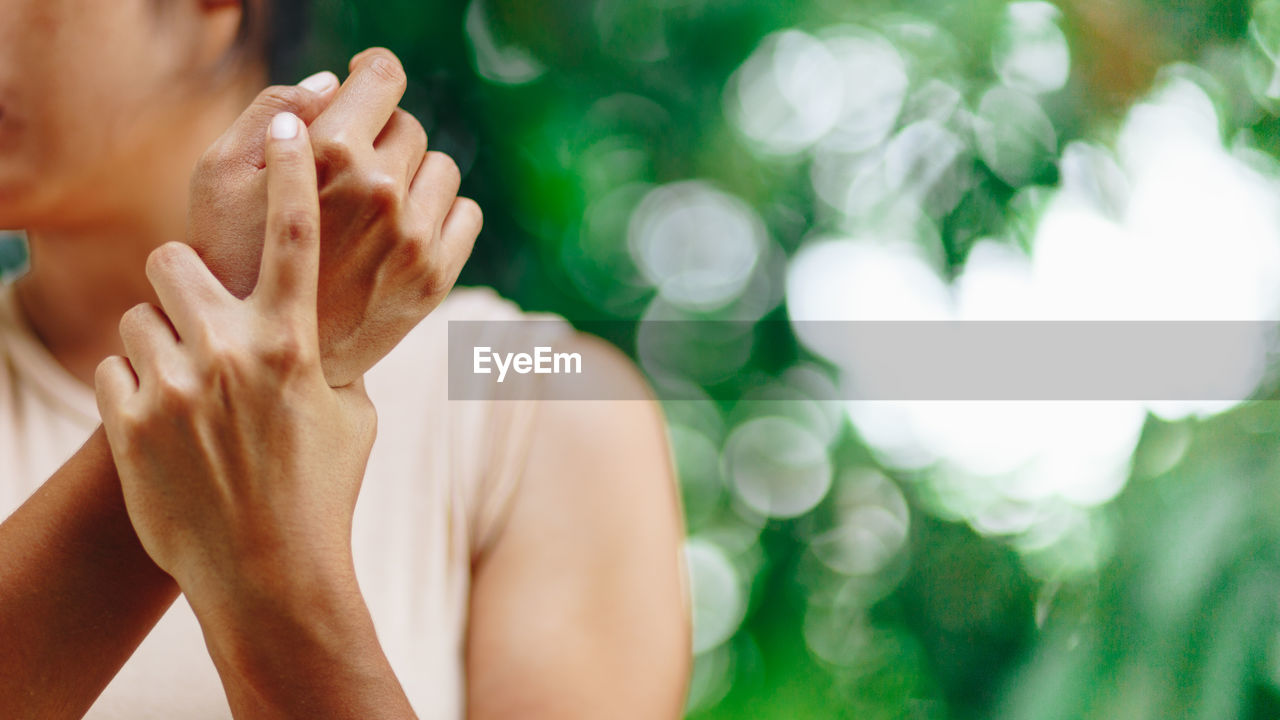human hand, hand, human body part, real people, focus on foreground, one person, close-up, body part, men, lifestyles, unrecognizable person, day, selective focus, leisure activity, sunlight, adult, outdoors, nature, finger, human limb, obscured face