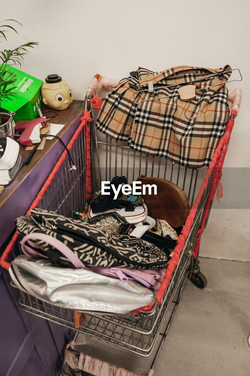 pets, domestic, domestic animals, animal, vertebrate, basket, no people, animal themes, mammal, container, shopping cart, large group of objects, one animal, cage, indoors, retail, art and craft, for sale, variation, sale