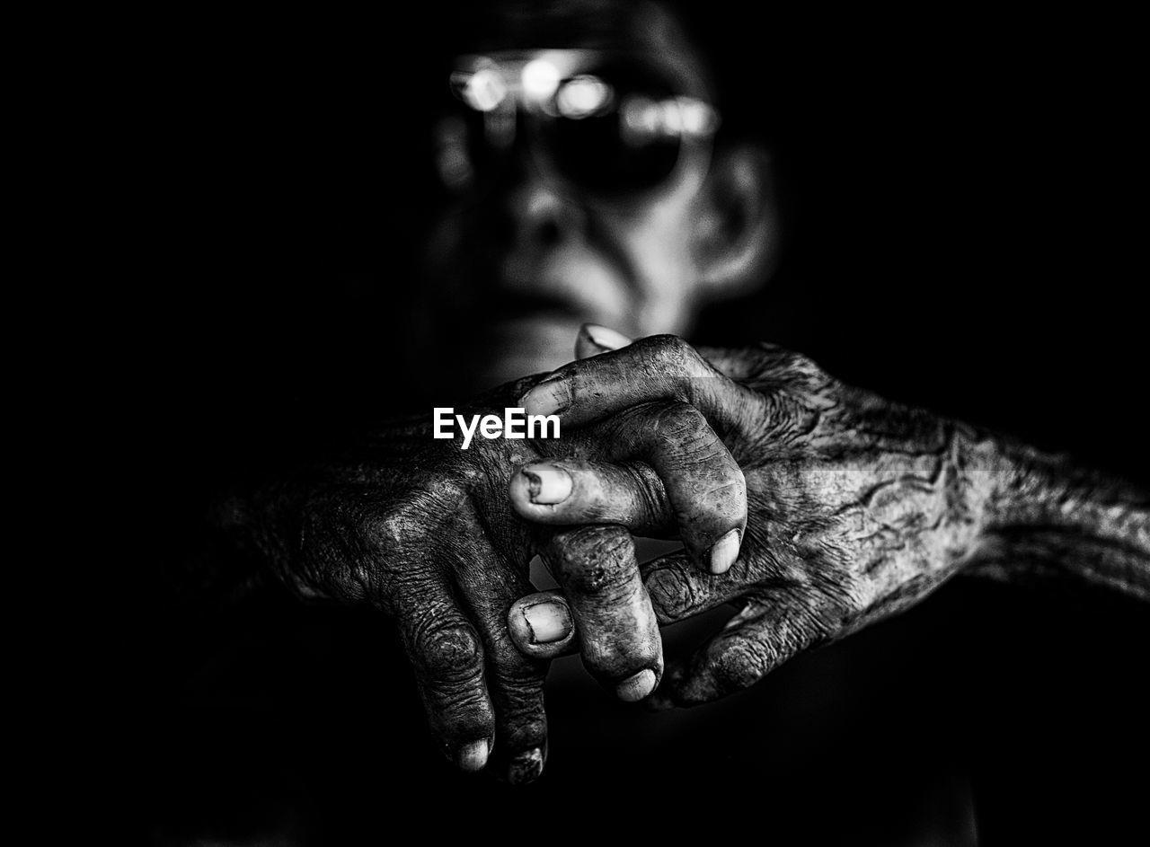 Close-up of senior man hands in darkroom