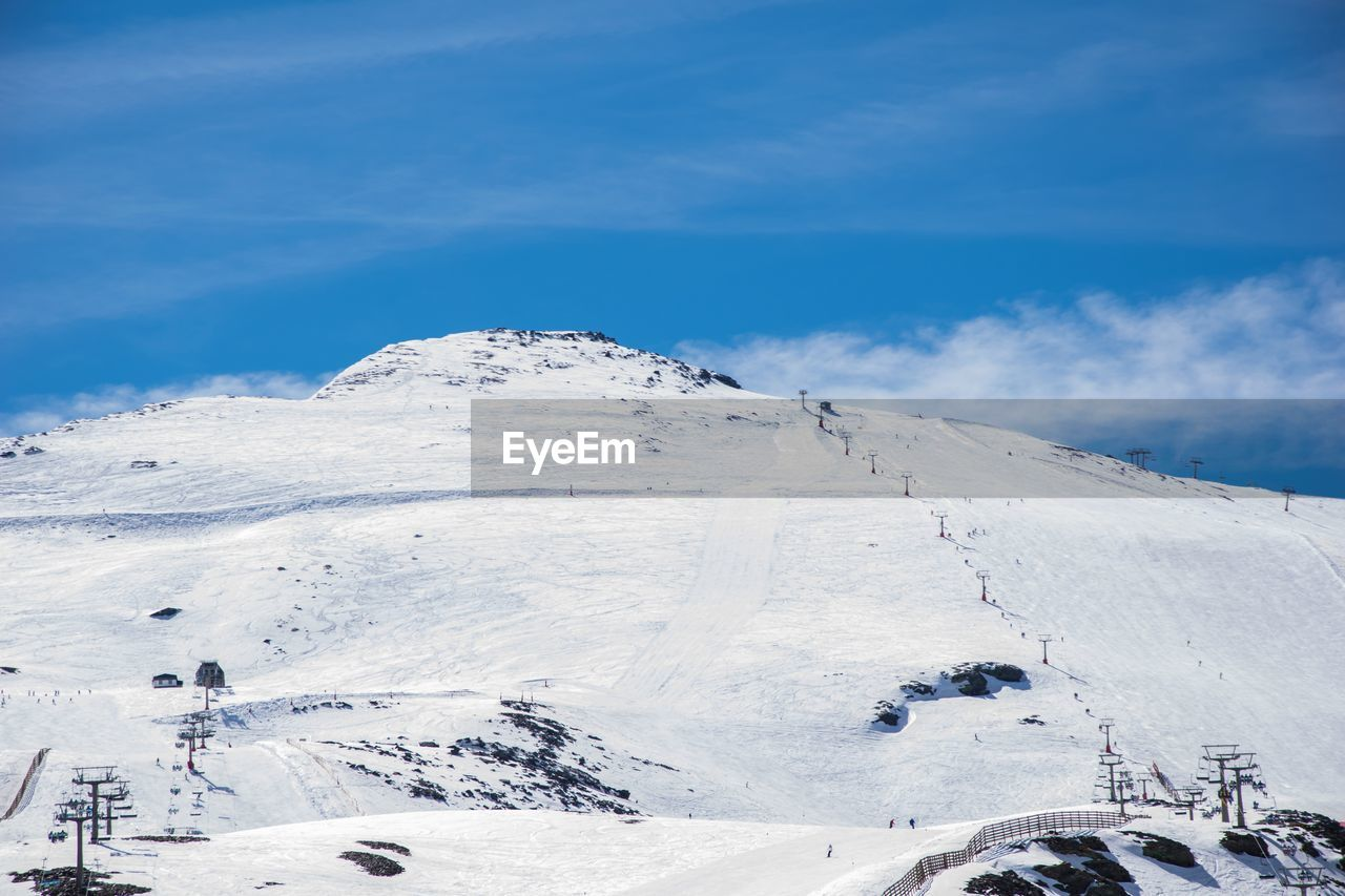 snow, cold temperature, winter, mountain, sky, beauty in nature, scenics - nature, cloud - sky, white color, snowcapped mountain, non-urban scene, day, tranquil scene, tranquility, nature, mountain range, environment, covering, landscape, no people, outdoors, mountain peak