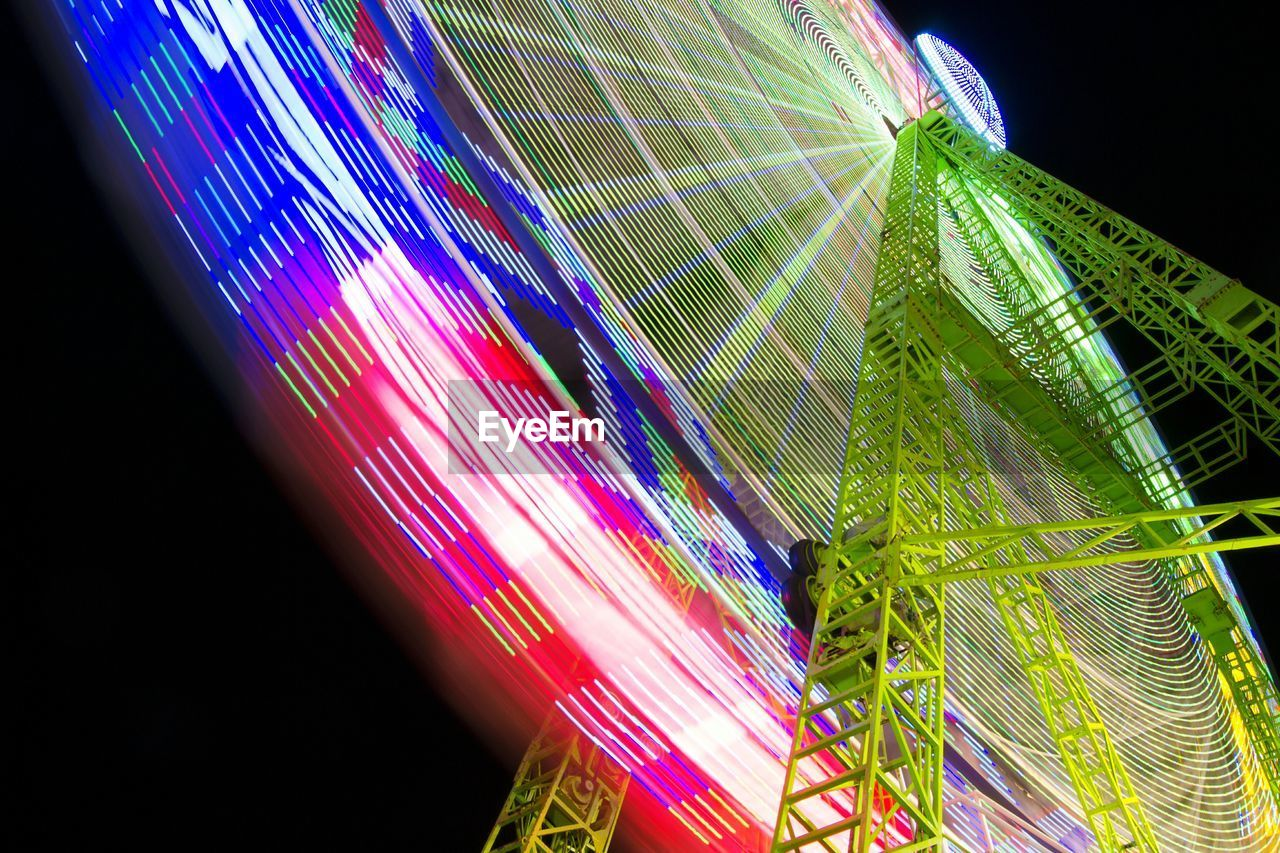 night, multi colored, low angle view, illuminated, no people, long exposure, close-up, outdoors, nature, beauty in nature, sky