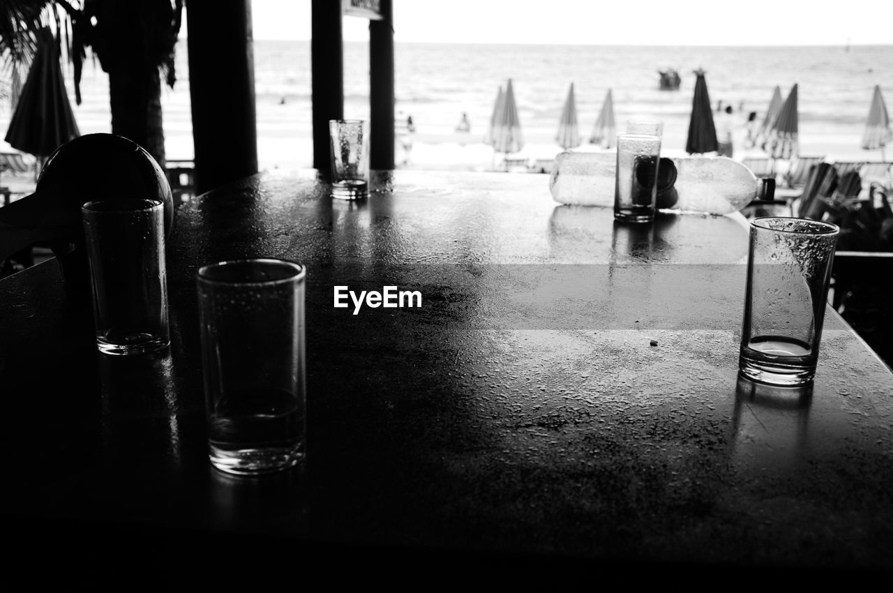 table, no people, water, sea, close-up, indoors, day