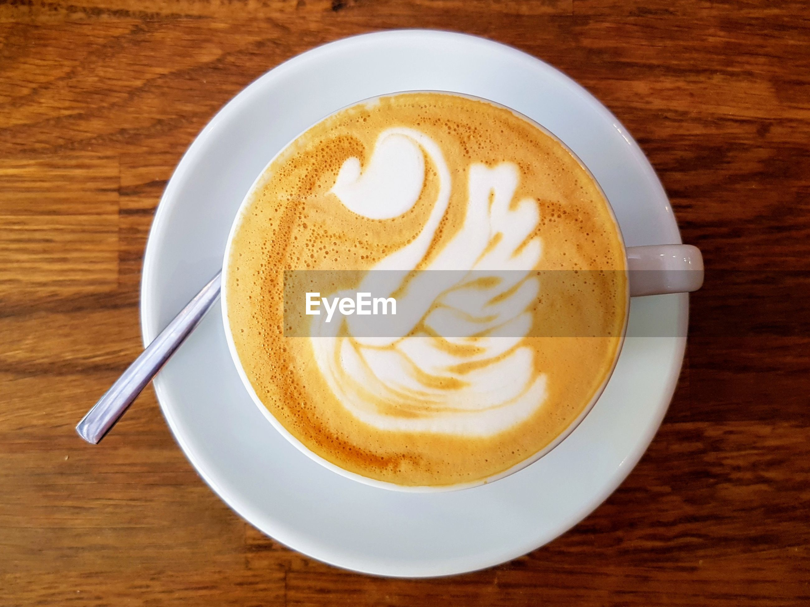 HIGH ANGLE VIEW OF CAPPUCCINO WITH COFFEE ON TABLE