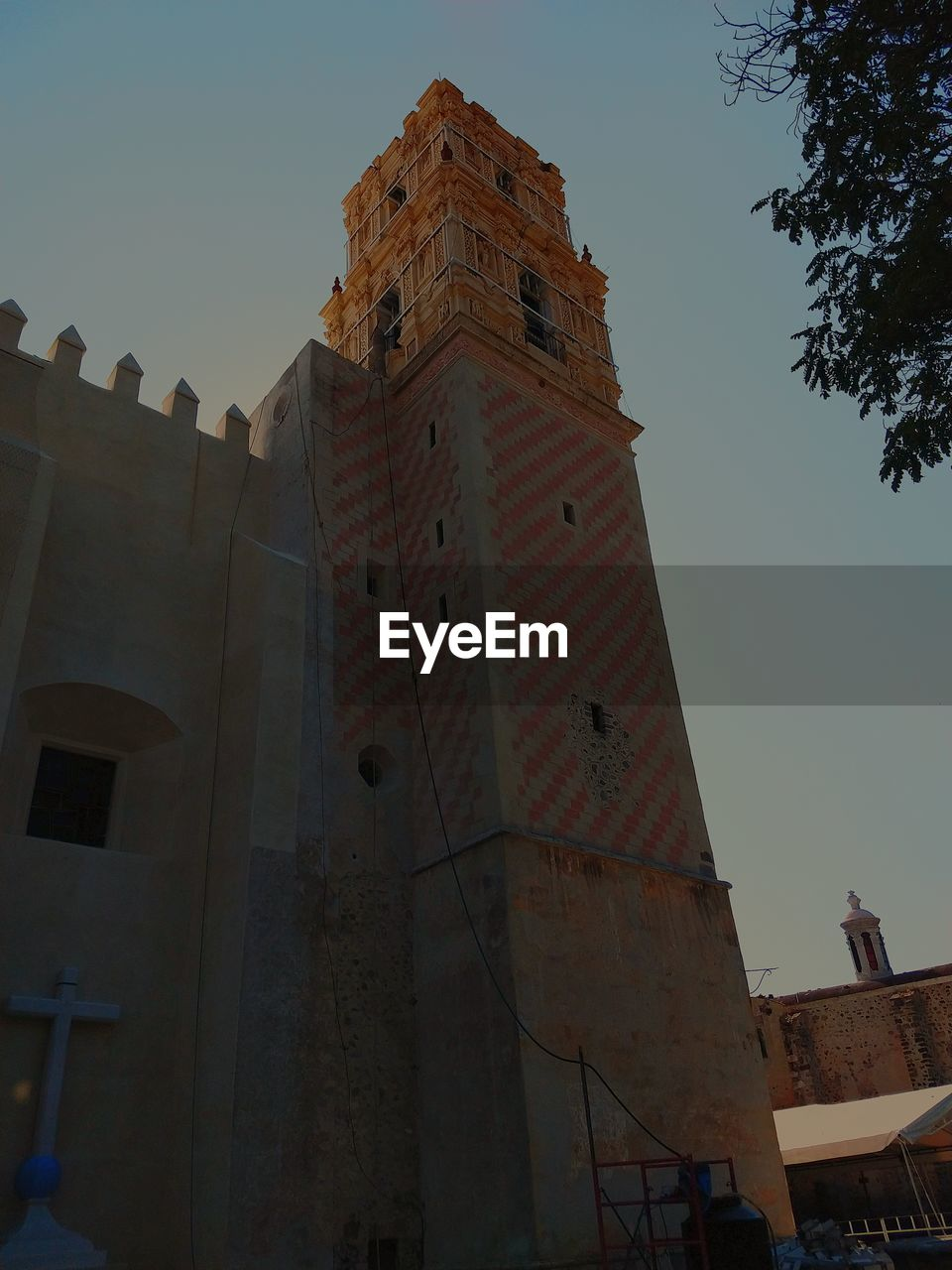 architecture, building exterior, low angle view, built structure, sky, building, nature, clear sky, no people, city, religion, belief, tower, place of worship, day, spirituality, the past, history, outdoors, tall - high