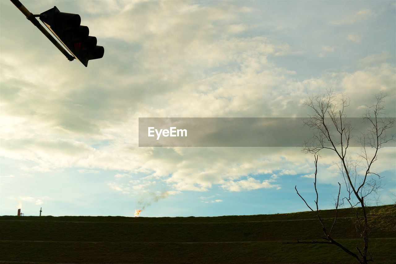 cloud - sky, sky, landscape, nature, no people, environment, beauty in nature, field, day, land, scenics - nature, plant, tranquility, outdoors, tranquil scene, tree, low angle view, non-urban scene, sign
