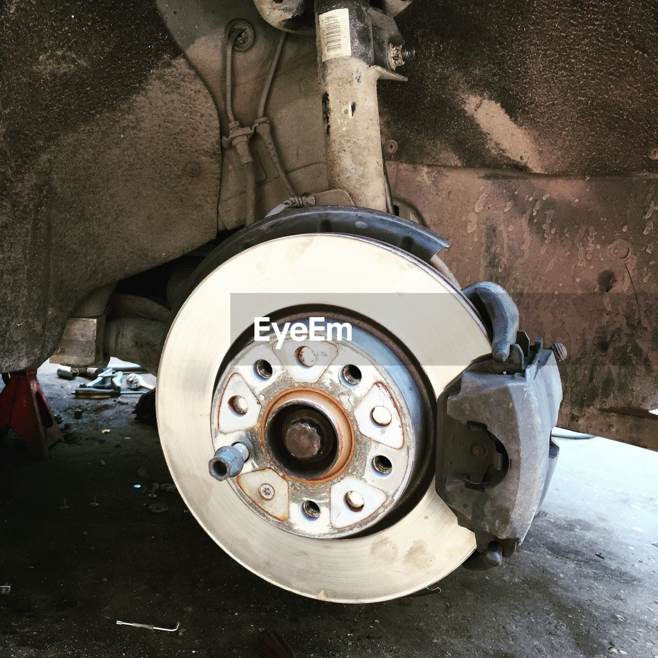 Cropped Image Of Vehicle Wheel On Street