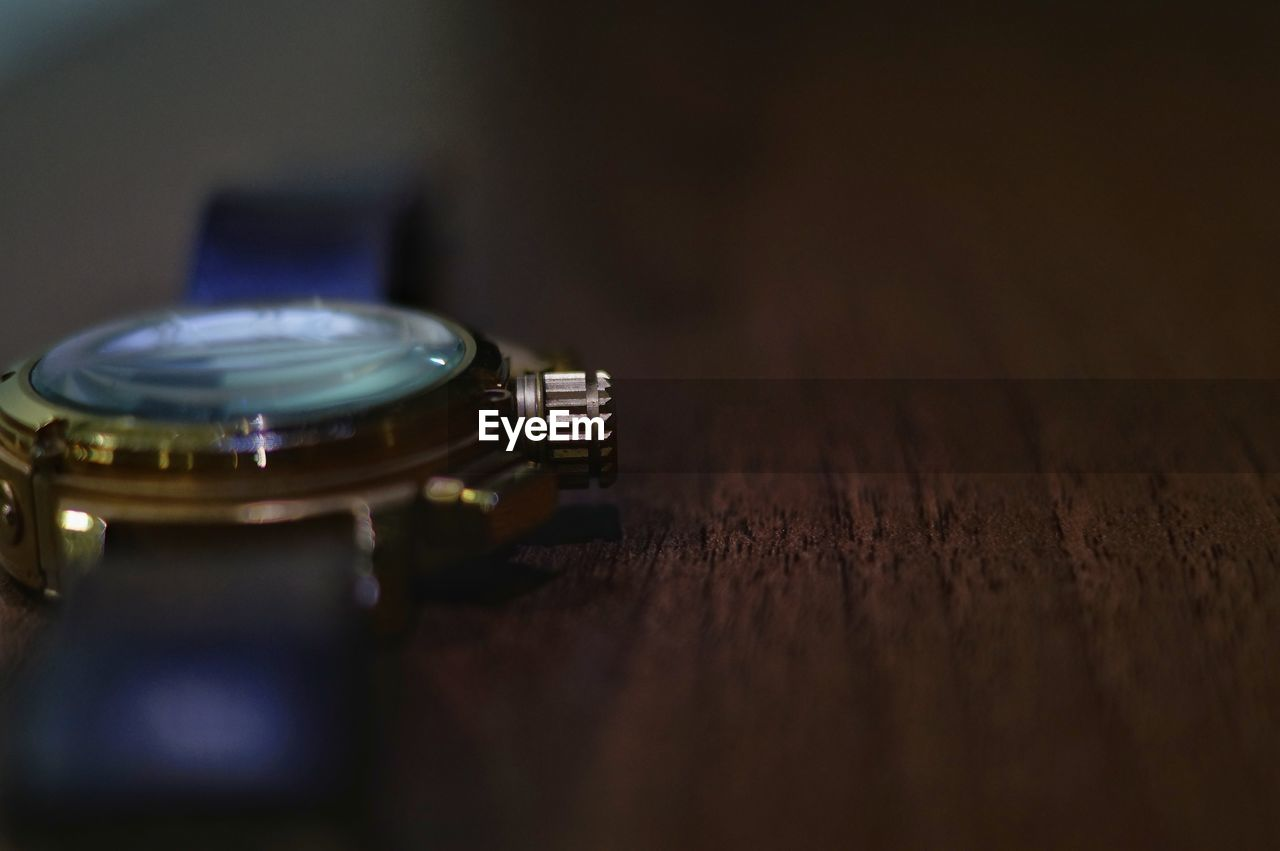 Close-up of wristwatch on table