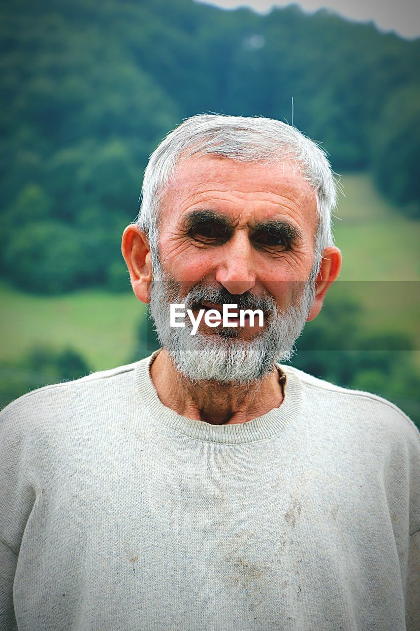 portrait, real people, adult, lifestyles, senior men, senior adult, males, facial hair, looking at camera, one person, front view, focus on foreground, men, headshot, day, beard, leisure activity, smiling, gray hair, mature men, mustache, white hair, human face