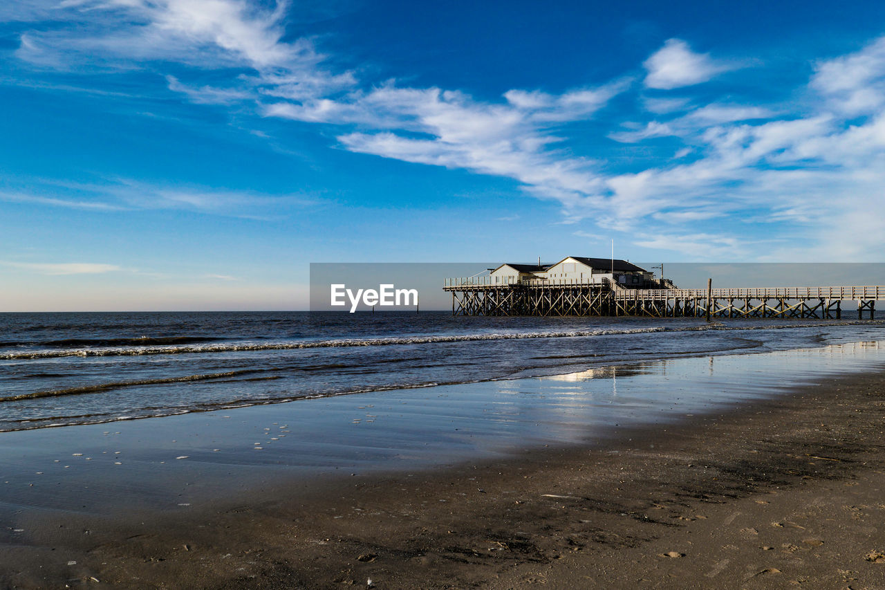 sky, water, architecture, built structure, sea, beach, cloud - sky, land, beauty in nature, scenics - nature, nature, building exterior, building, horizon over water, day, tranquil scene, no people, tranquility, horizon, outdoors