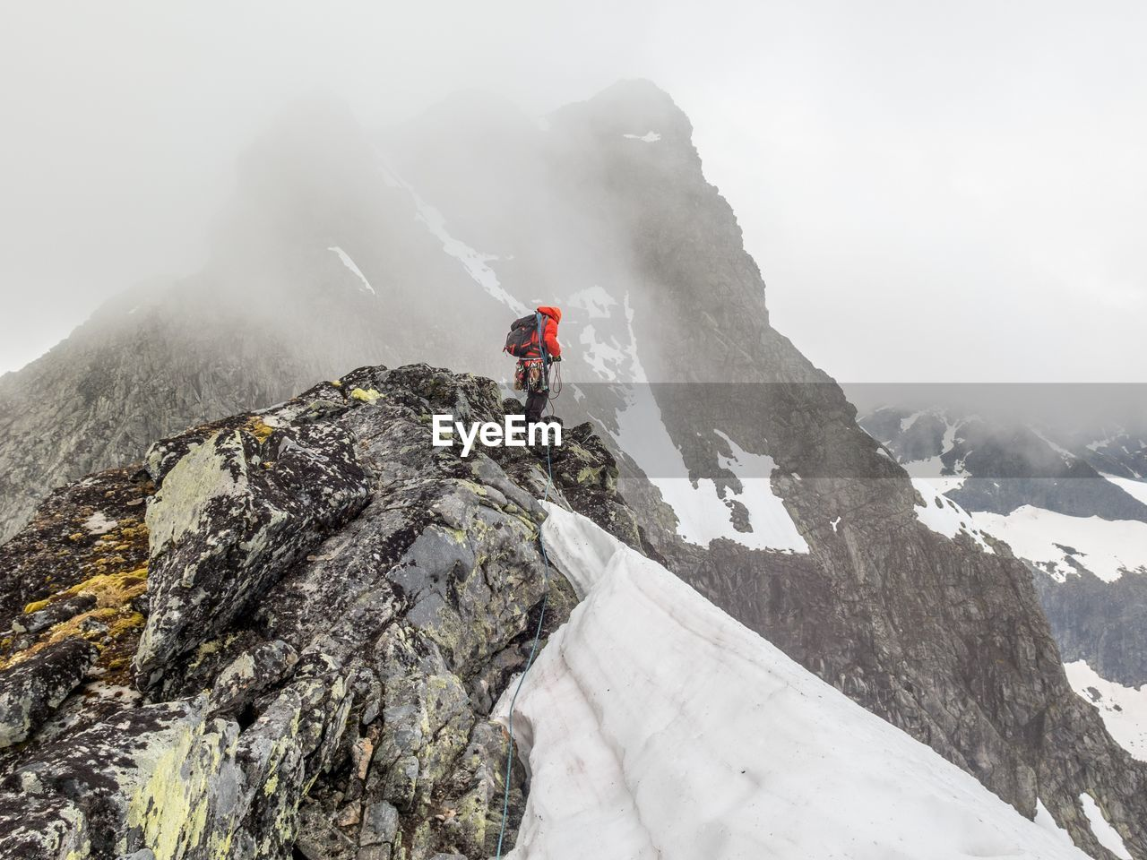 View Of Person Standing On Snow Covered Mountain