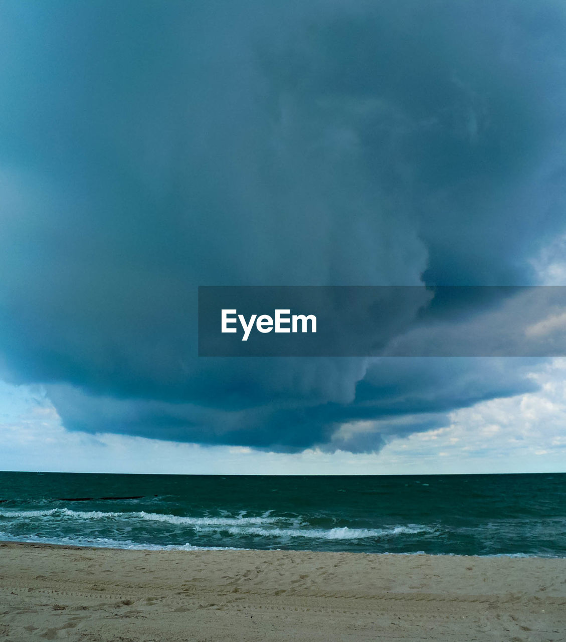 sea, sky, cloud - sky, land, water, beach, horizon, beauty in nature, scenics - nature, horizon over water, storm, motion, nature, wave, day, power in nature, power, tranquility, no people, outdoors, ominous