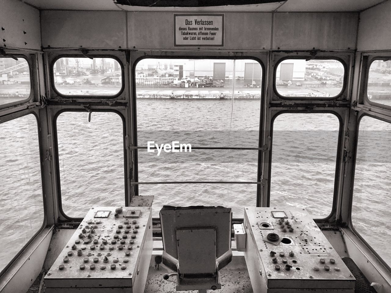 Ferry sailing on sea seen through windows
