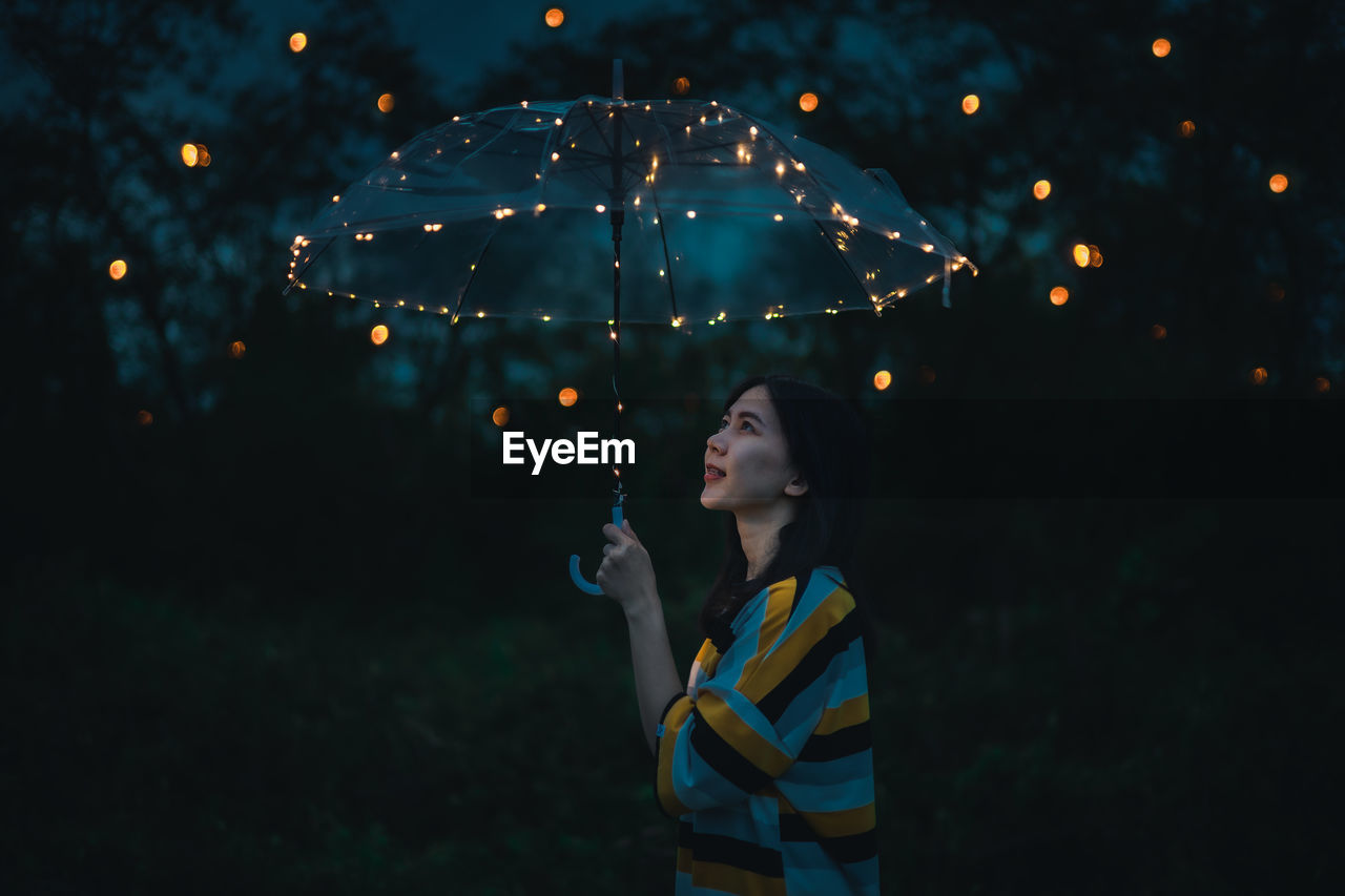Woman looking up at night