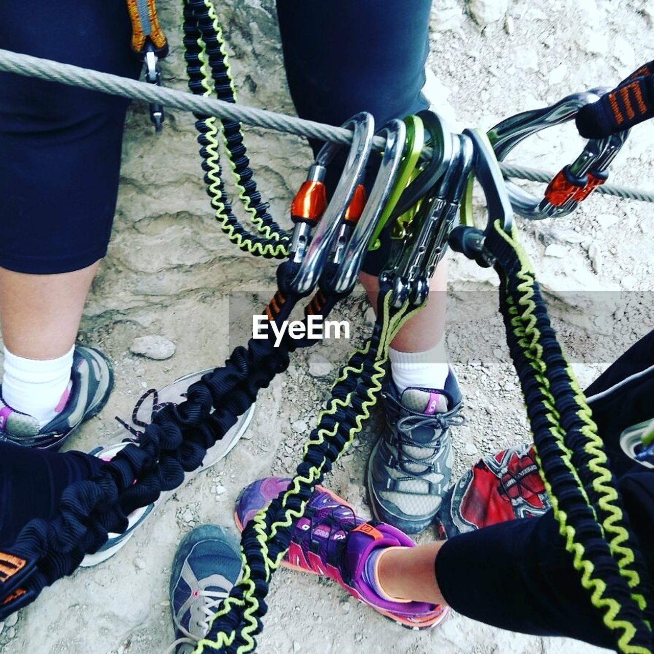low section, human leg, high angle view, real people, day, shoe, outdoors, lifestyles, human body part, leisure activity, bicycle, standing, sport, men, close-up, people, adult