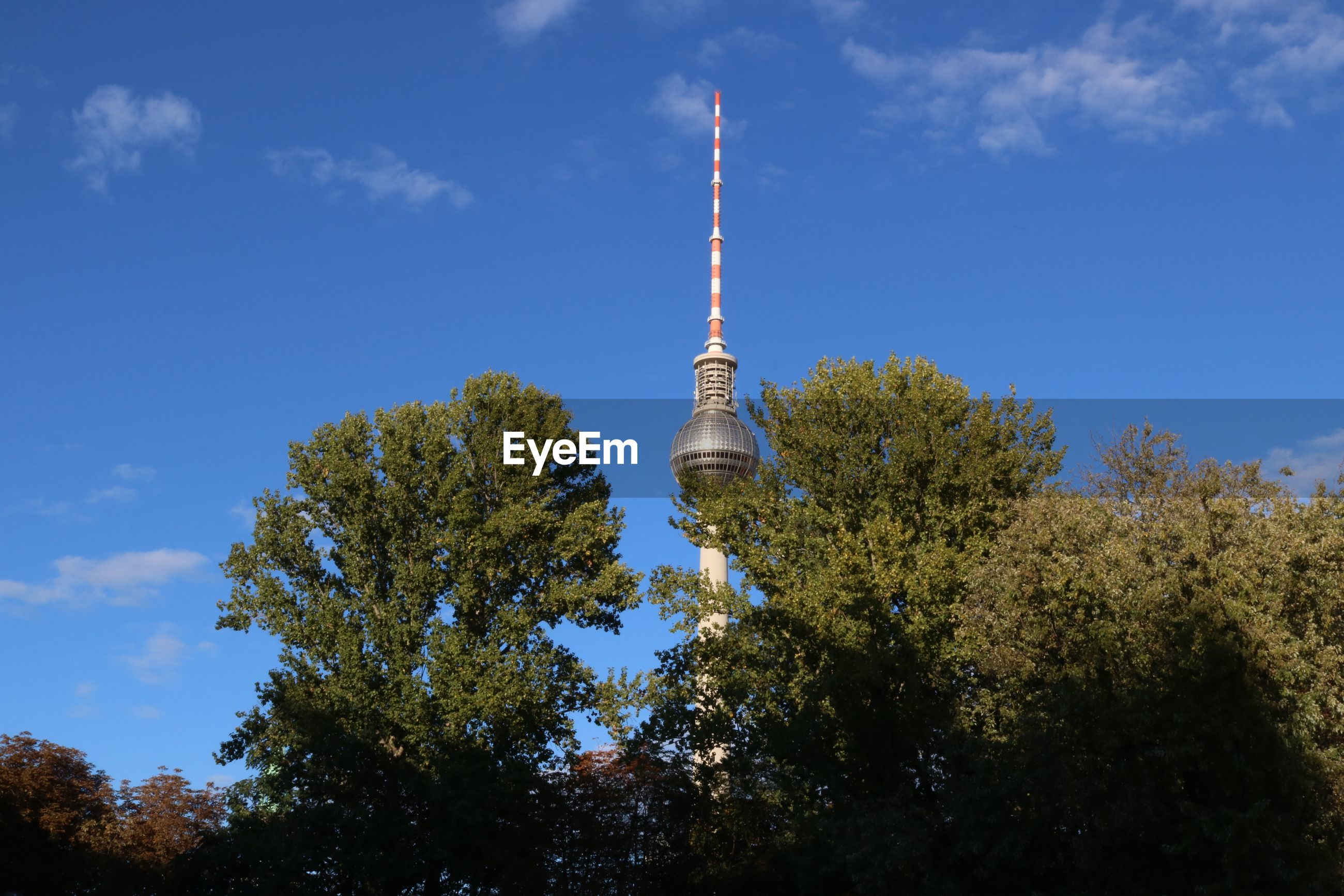 Low angle view of fernsehturm against blue sky