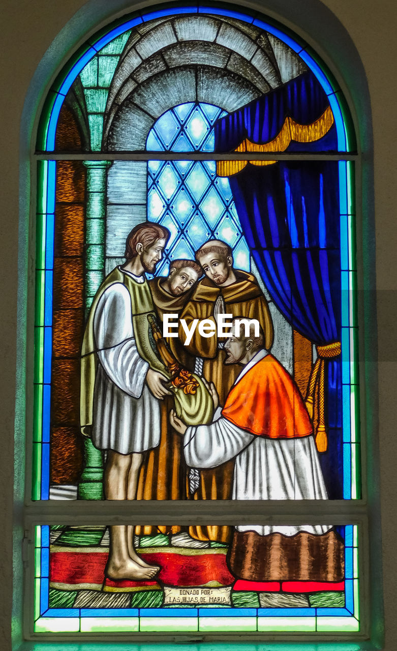 religion, human representation, representation, belief, window, art and craft, architecture, spirituality, male likeness, stained glass, female likeness, place of worship, creativity, arch, indoors, built structure, glass, no people
