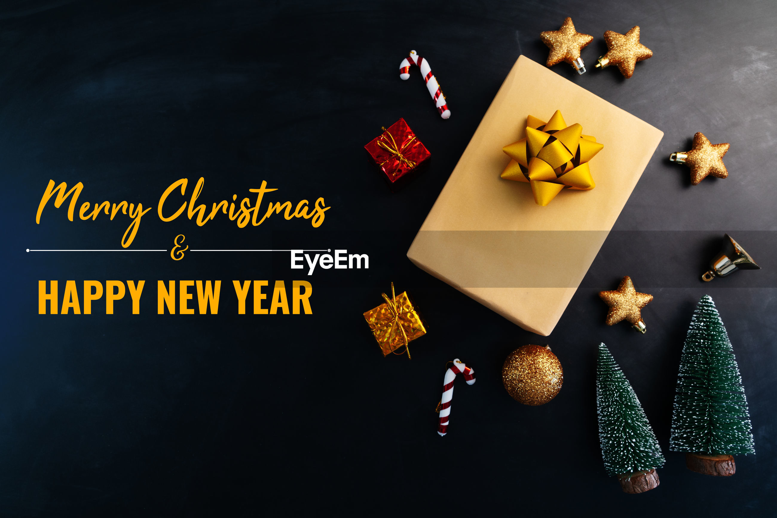 Merry christmas and happy new year, present gift and decoration on black background
