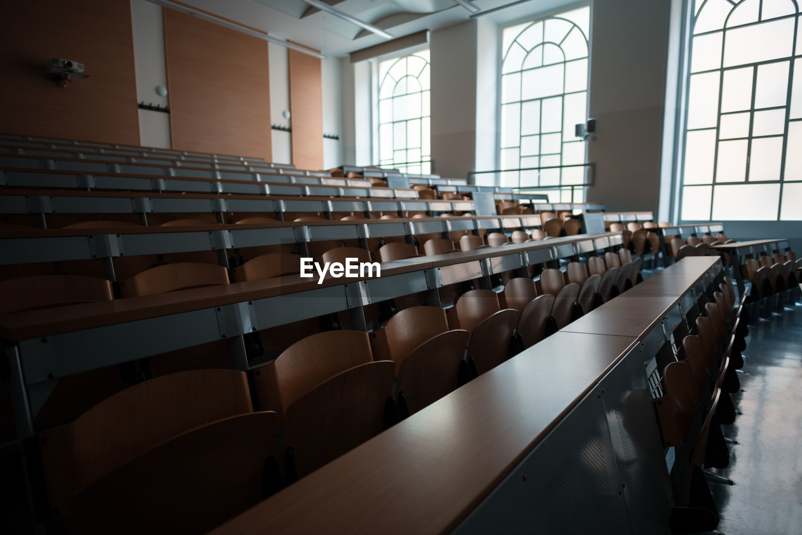 EMPTY CHAIRS AND TABLES IN A ROOM