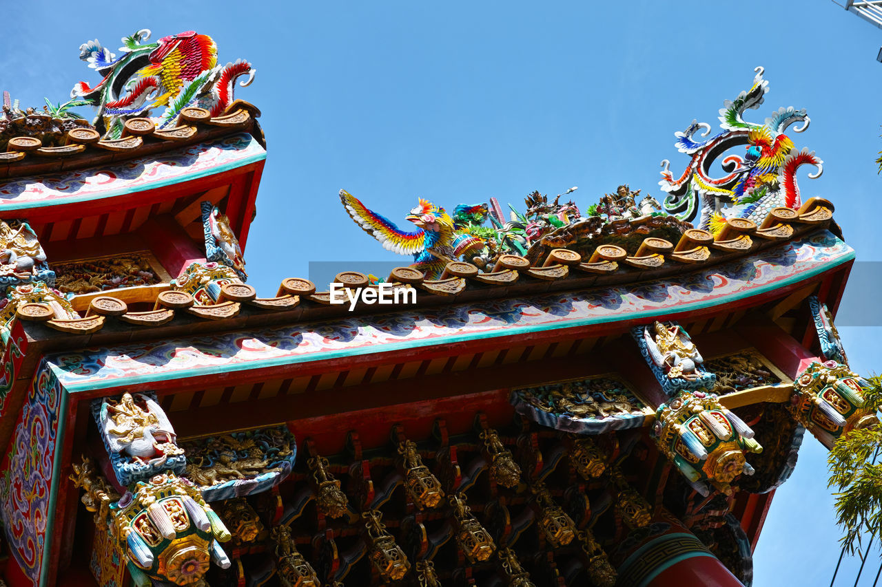 Low angle view of colorful traditional building against clear sky