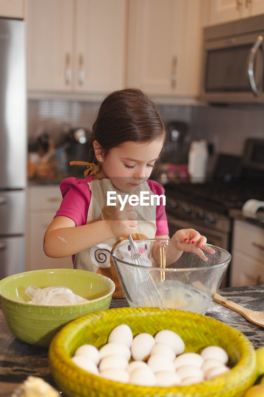 Cute Girl Preparing Food In Kitchen