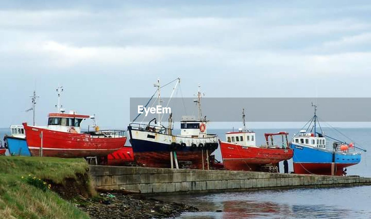 nautical vessel, transportation, moored, cloud - sky, mode of transport, sky, boat, day, no people, harbor, outdoors, water, nature, sea, tranquility, scenics, mast