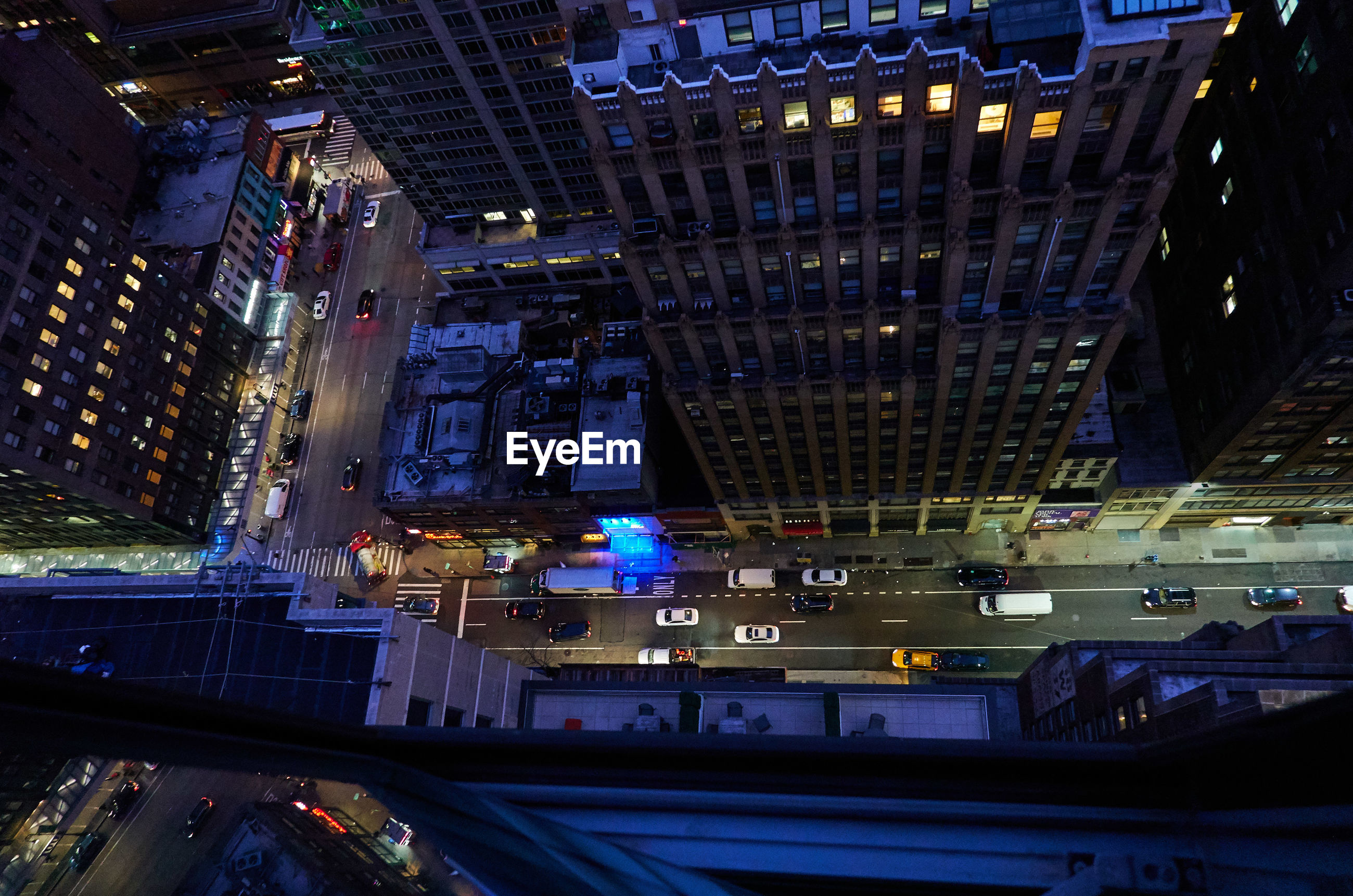 High angle view of illuminated new york city street and buildings at night