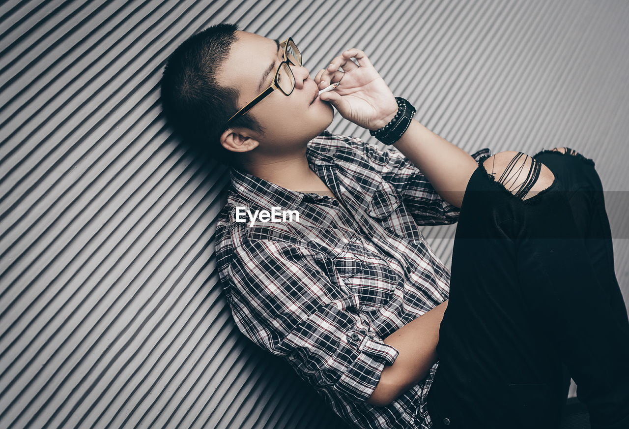 Young Man Smoking