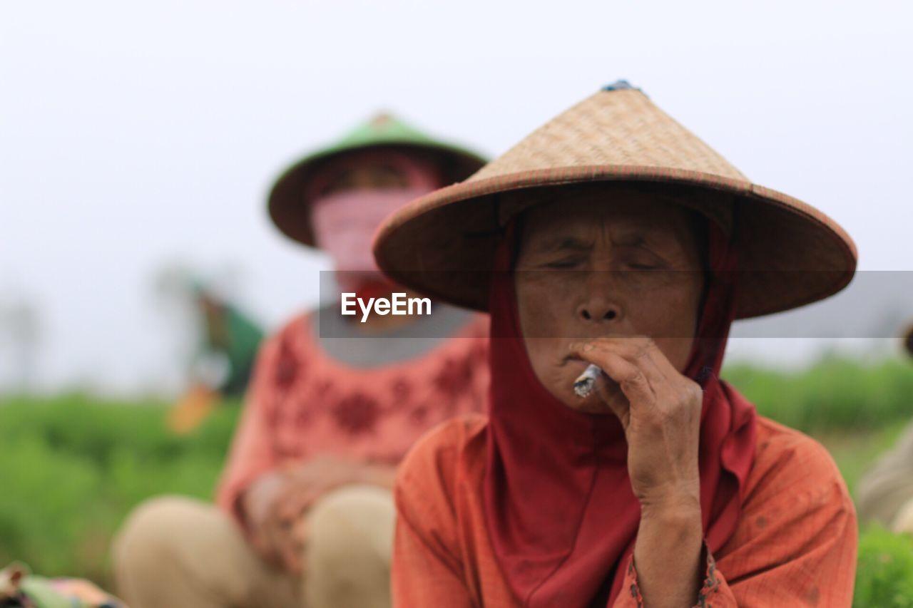 Senior Woman Smoking Marijuana Joint At Farm