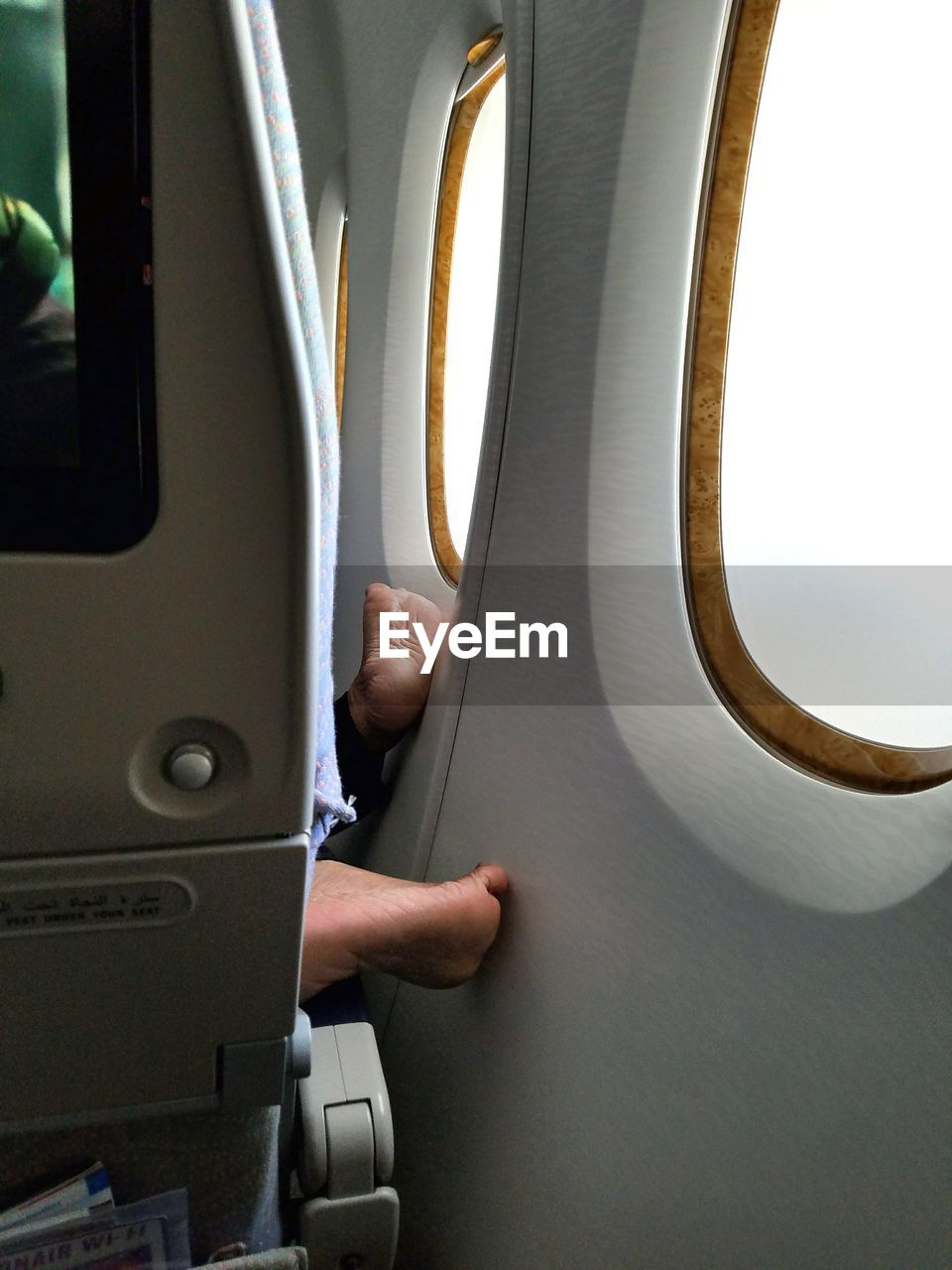 air vehicle, airplane, transportation, mode of transportation, vehicle interior, travel, public transportation, window, journey, flying, real people, human hand, seat, one person, men, human body part, vehicle seat, hand, day, outdoors, finger, aerospace industry, piloting