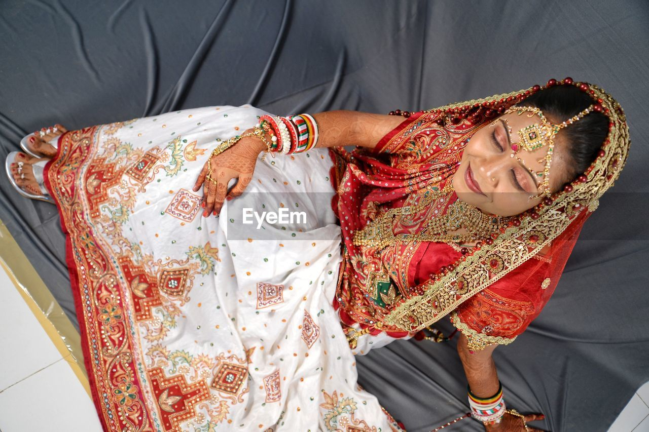 real people, traditional clothing, clothing, lifestyles, indoors, women, two people, people, life events, front view, event, emotion, adult, pattern, leisure activity, females, wedding, bride, wedding ceremony, positive emotion, floral pattern