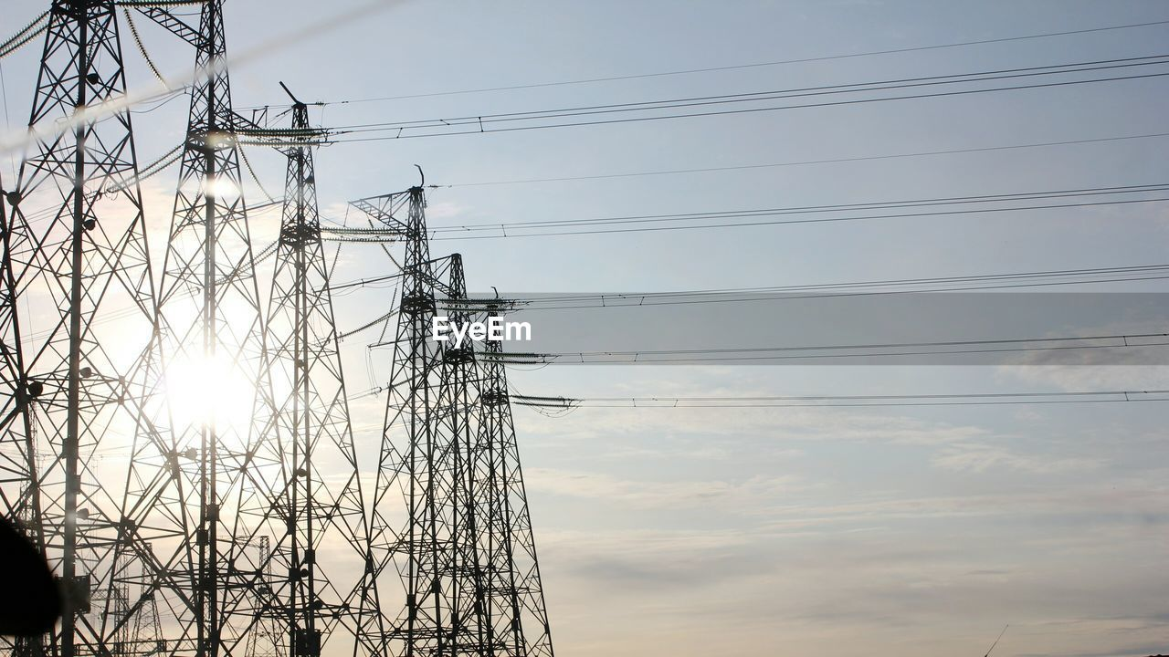cable, electricity pylon, electricity, power supply, connection, power line, fuel and power generation, sky, technology, cloud - sky, no people, day, low angle view, outdoors, power station
